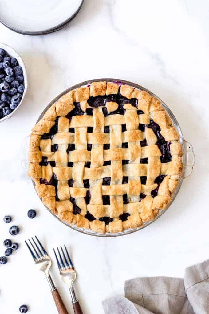 A homemade lattice crust on a blueberry pie.
