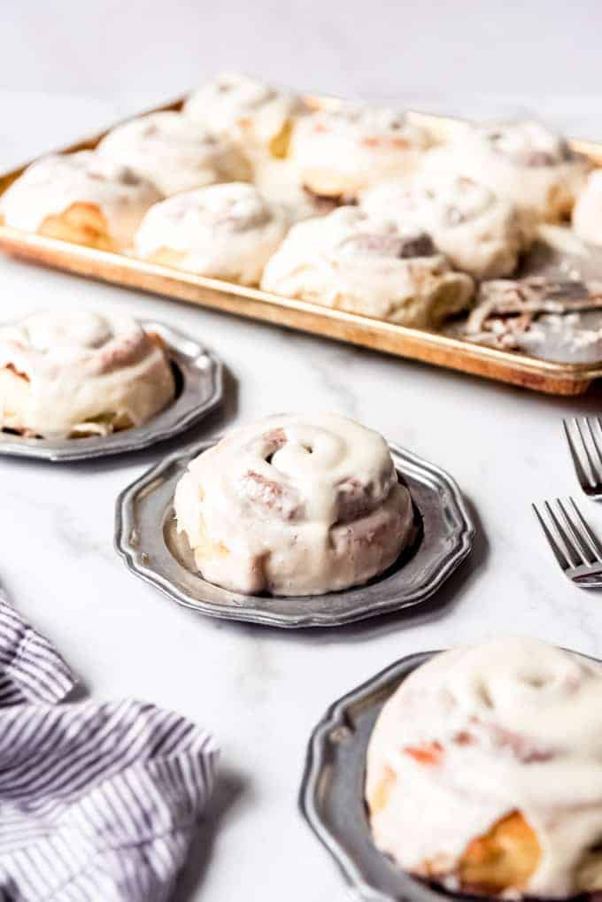 An image of cinnamon rolls on plates.