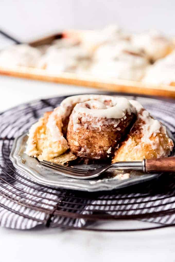 An image of a soft homemade cinnamon roll on a plate.