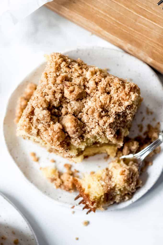 An image of a piece of coffee cake with streusel on a plate.