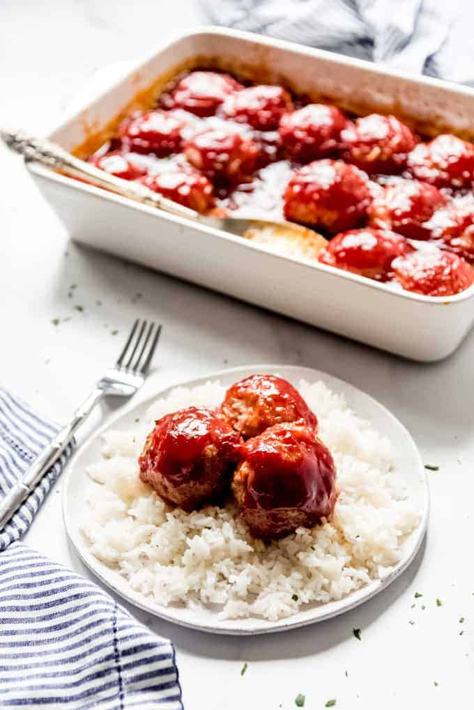 An image of a plate of ham balls and rice.