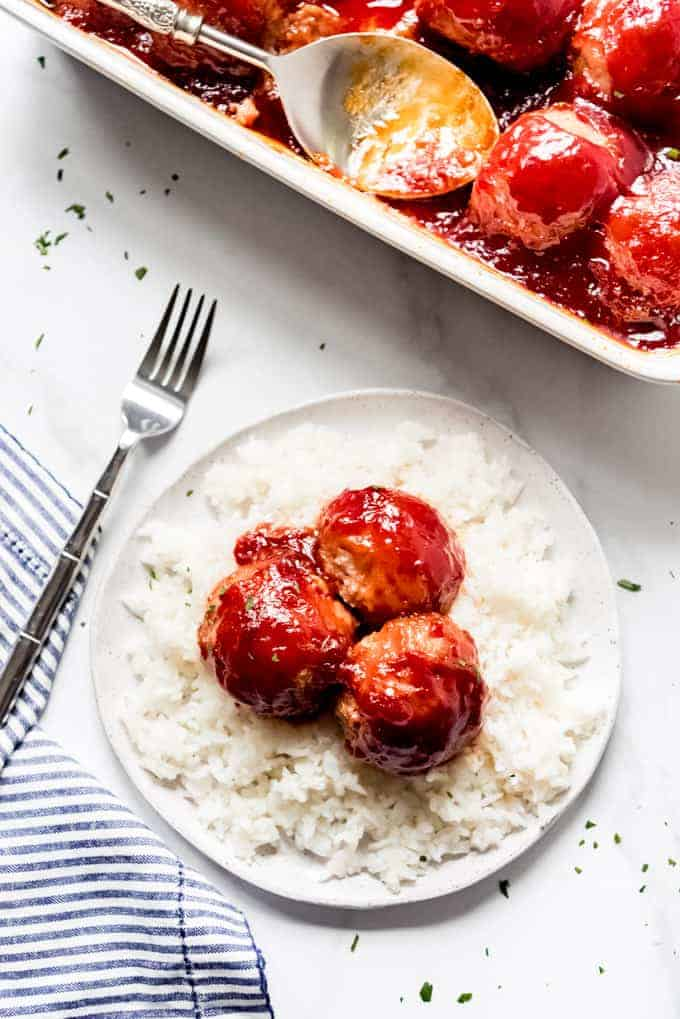 An image of ham balls on a bed of white rice.