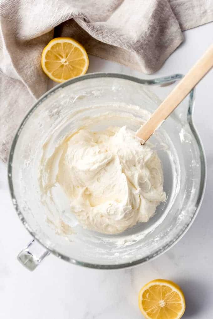 An image of a bowl of whipped lemon buttercream frosting.