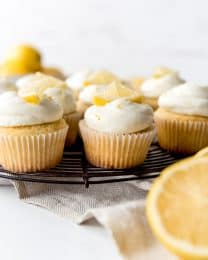 An image of lemon cupcakes on a wire cooling rack.