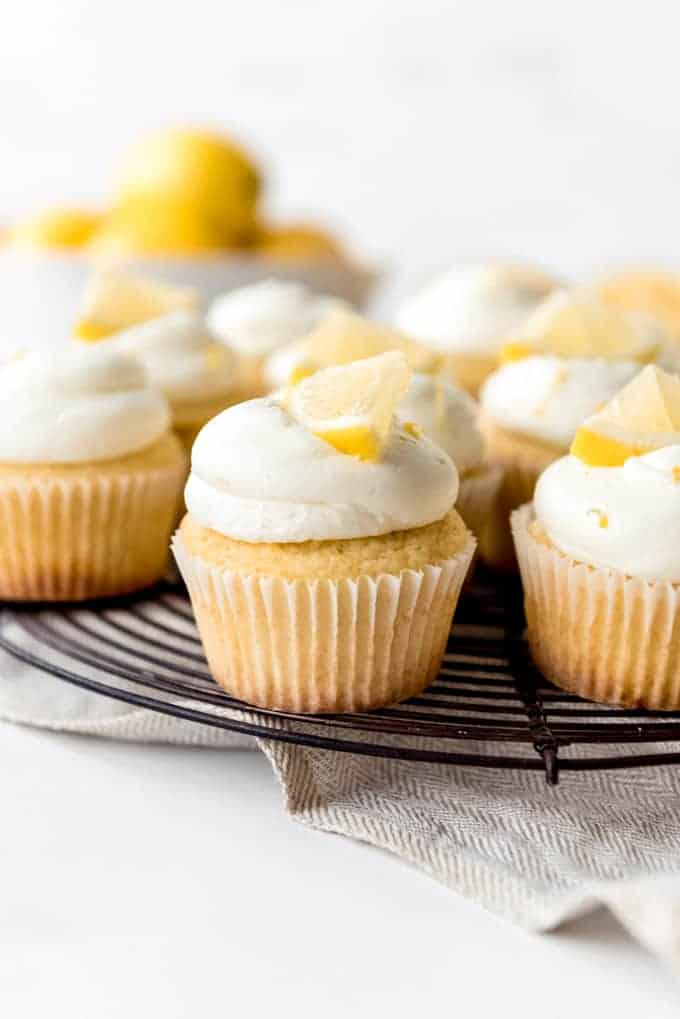 An image of fresh lemon cupcakes with lemon frosting.