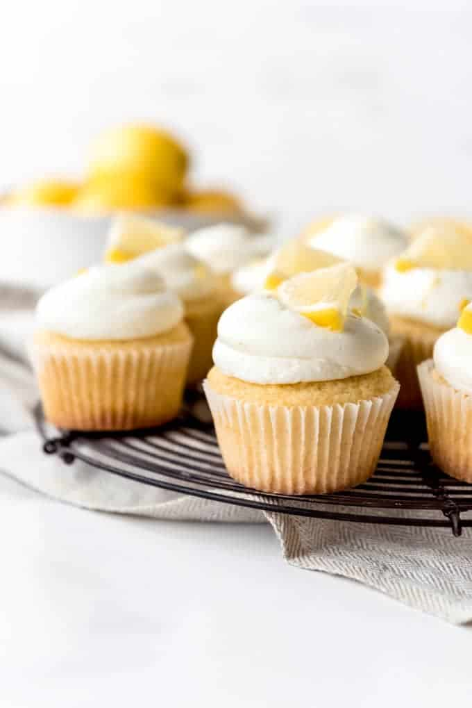 An image of homemade lemon cupcakes with lemon buttercream frosting.