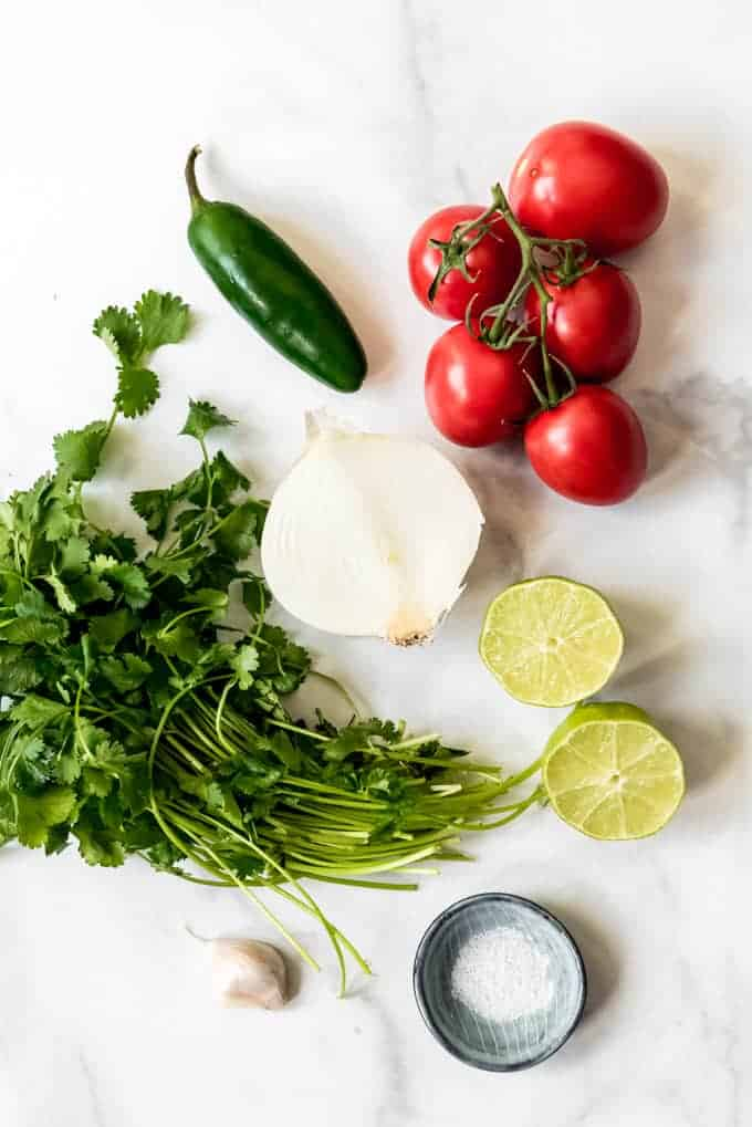 An image of the ingredients for pico de gallo.