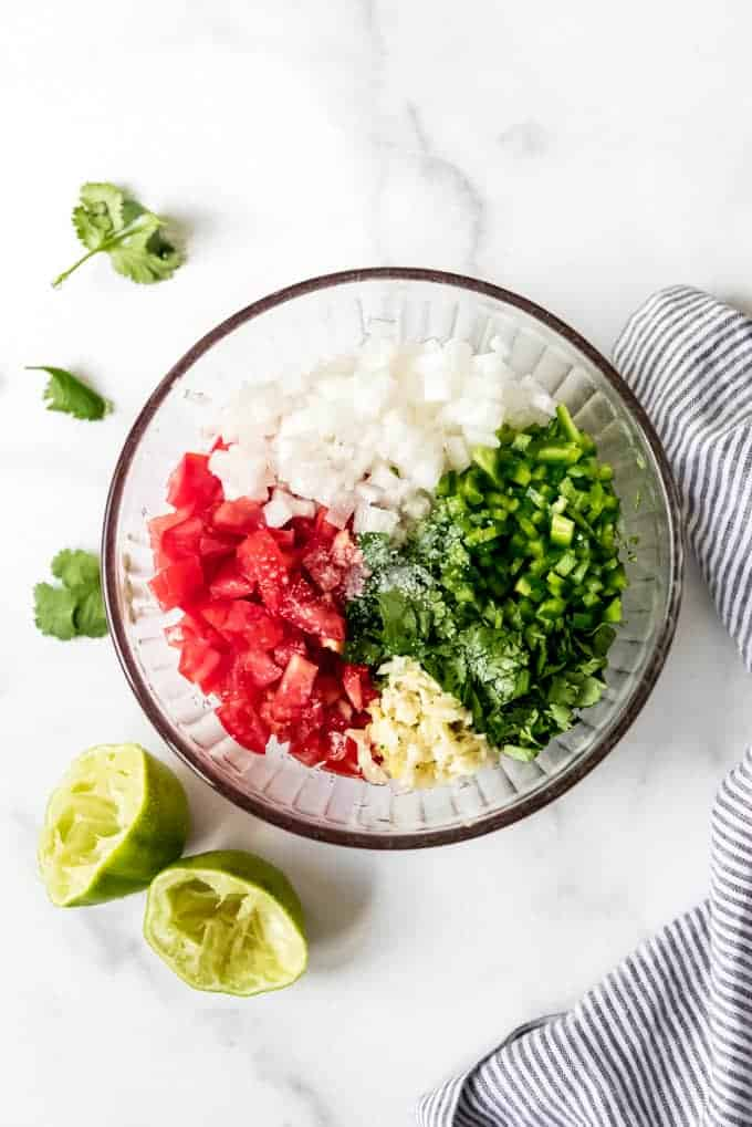 An image of a bowl of the ingredients for Mexican salsa fresca.