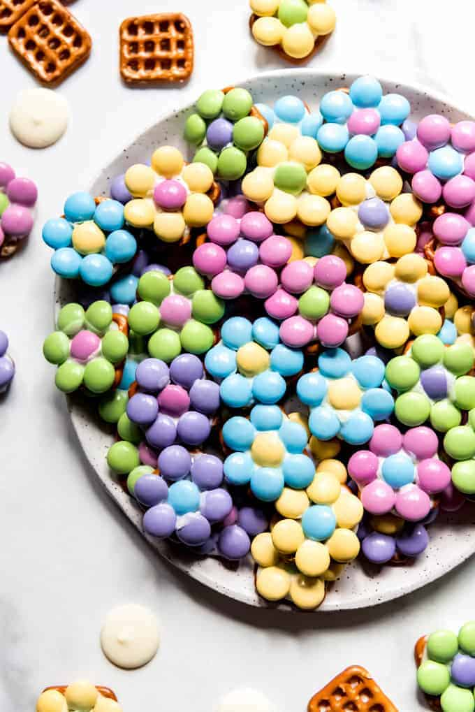 An image of Easter flower pretzel bites in pastel colors on a plate.