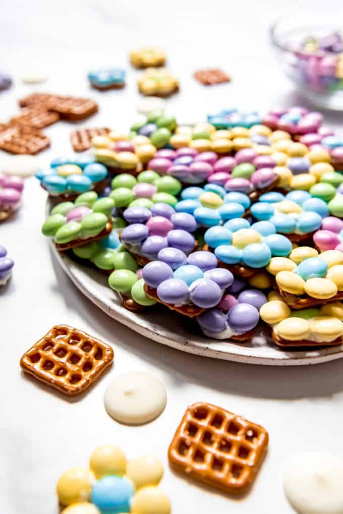 An image of Spring pretzel bites made with M&M's arranged in the shape of flowers and secured with white chocolate.