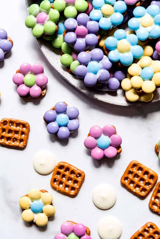 "An up-close image of Easter candy ""flowers"" made with M&M's, white chocolate, and pretzels."