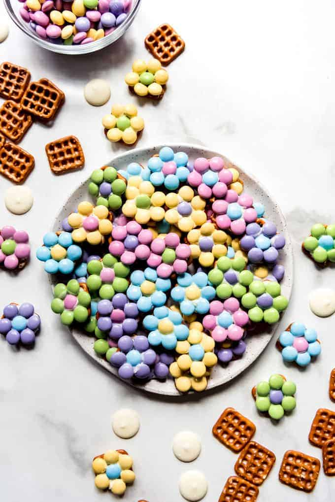An image of an easy Easter treat for kids to make at home with pretzels, white chocolate, and M&M's.