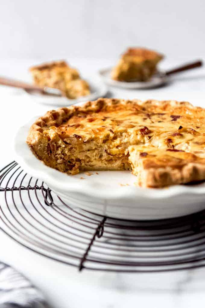 An image of the Pioneer Woman's Cowboy Quiche with two slices removed from it.
