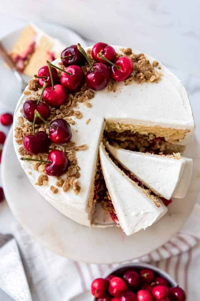 A cherry crisp cake with a couple of slices removed.