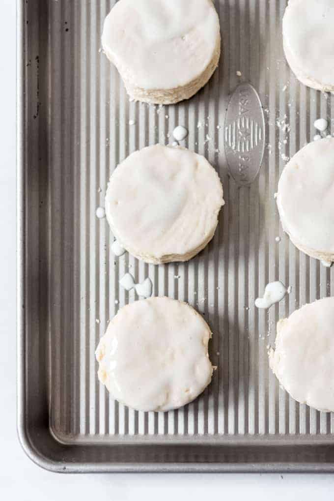Buttermilk brushed biscuits on a baking tray