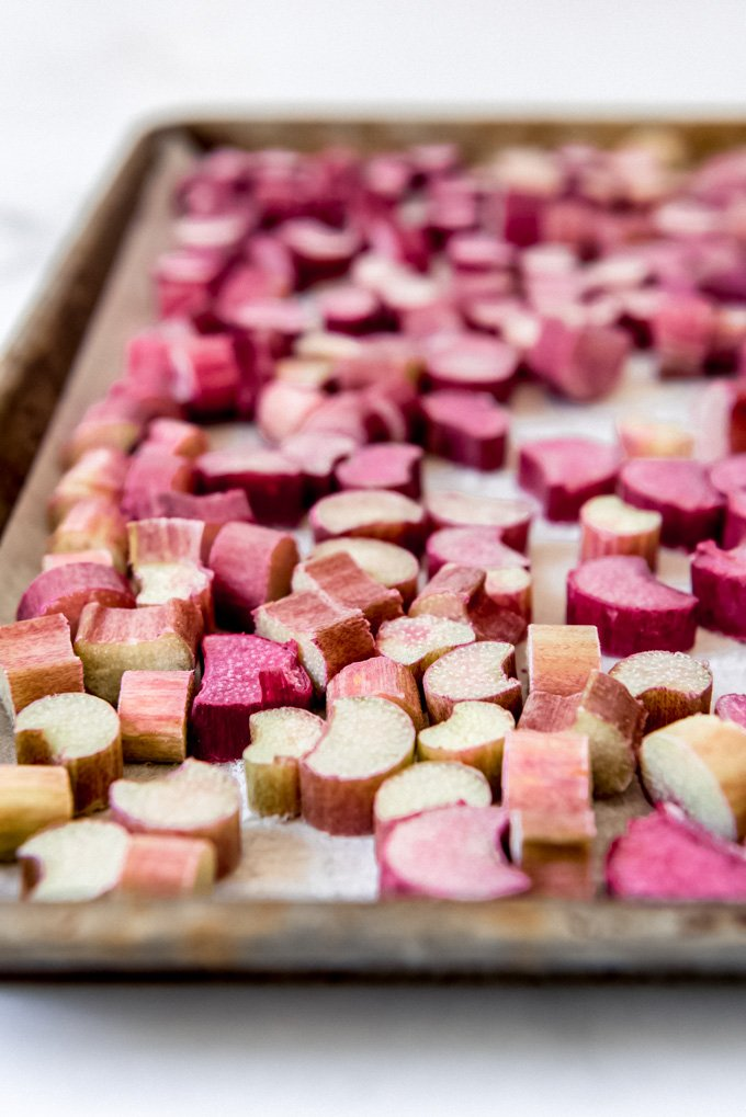 Individually frozen pieces of rhubarb on a baking sheet.
