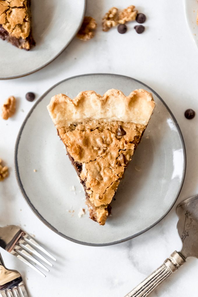 A slice of Kentucky Chocolate Walnut Pie on a dessert plate.