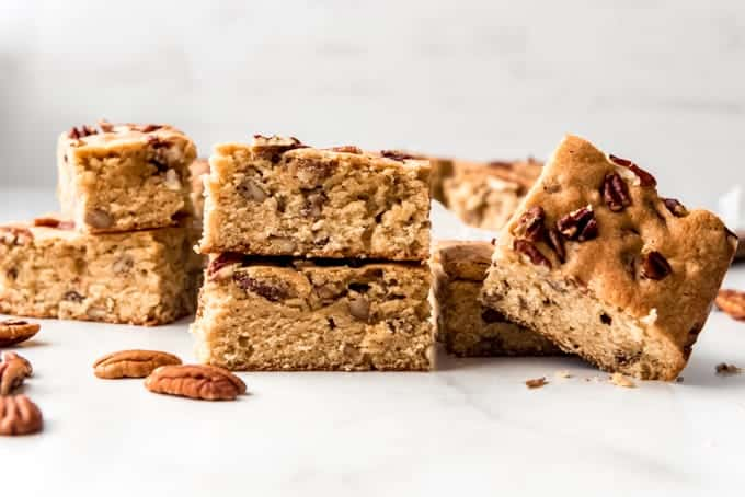 Maple pecan blondies stacked on top of each other.