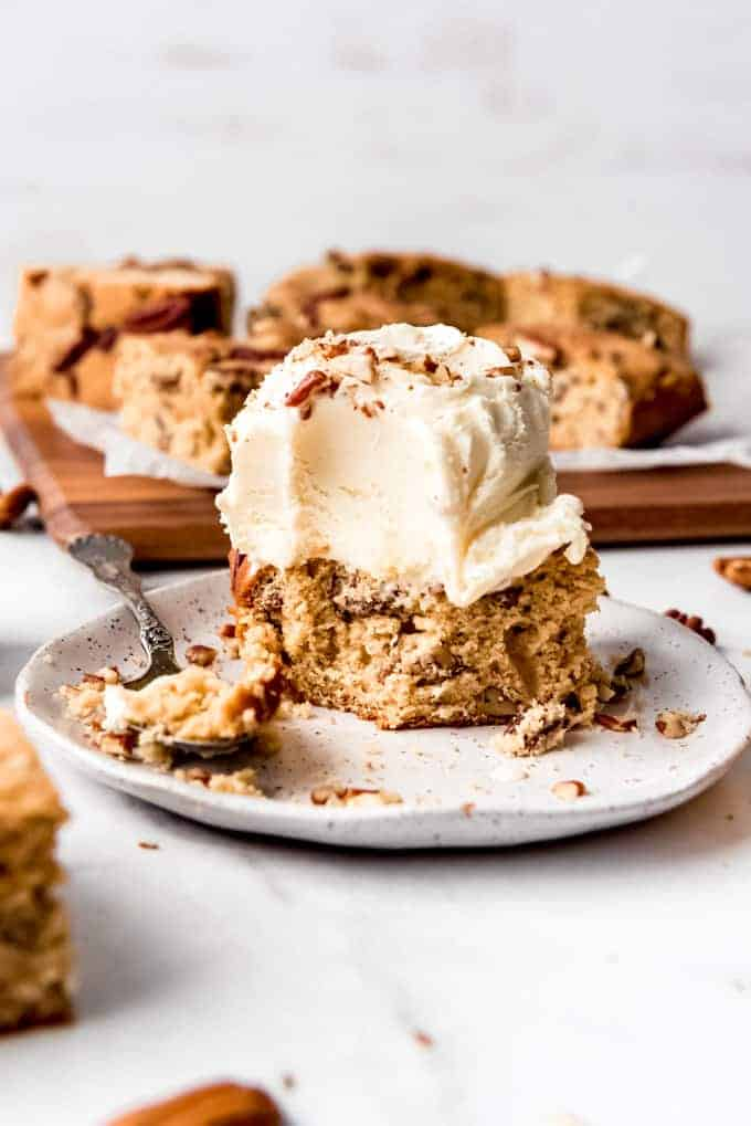 A maple walnut blondie topped with a scoop of vanilla ice cream.