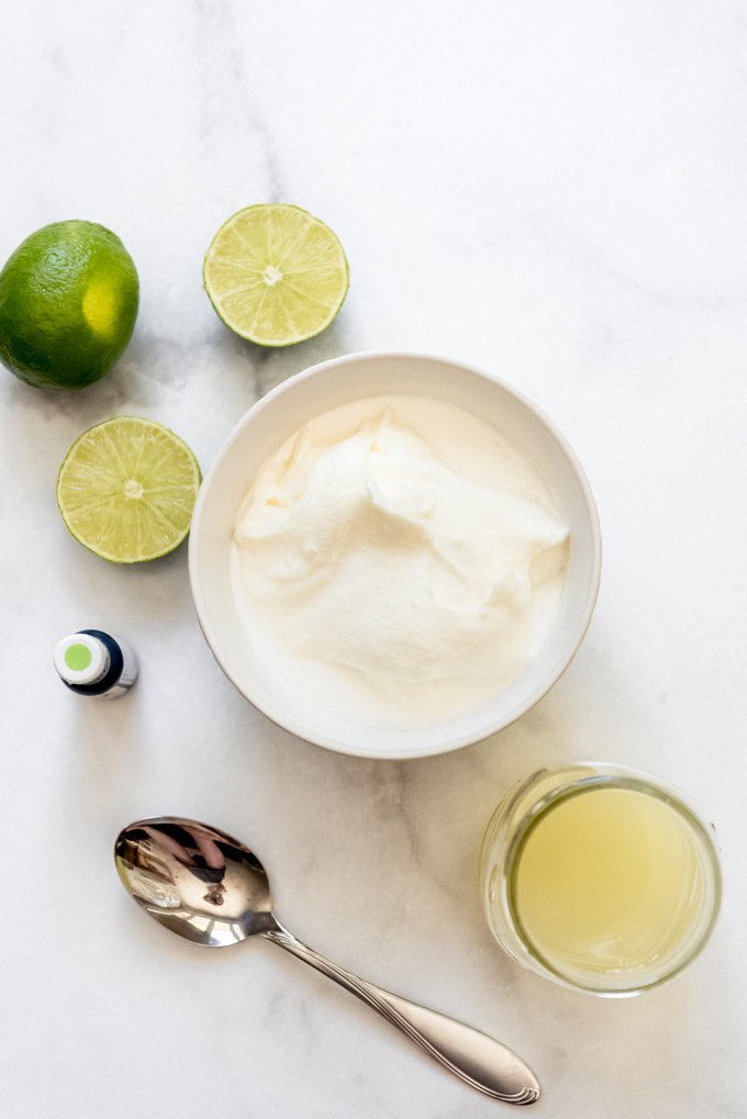A white bowl filled with sherbet base next to lime juice.