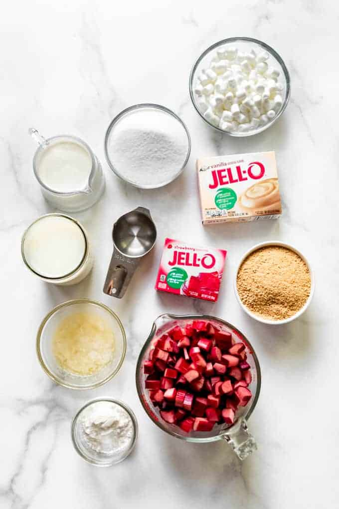 All of the ingredients in separate bowls for making a layered rhubarb pudding dessert.