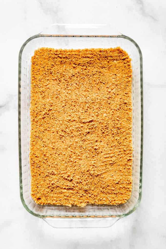 graham cracker crust pressed into a glass baking dish