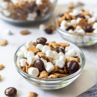 Glass bowls filled with smores snack mix