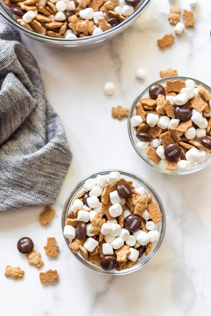 Individual serving bowls of s'mores snack mix.