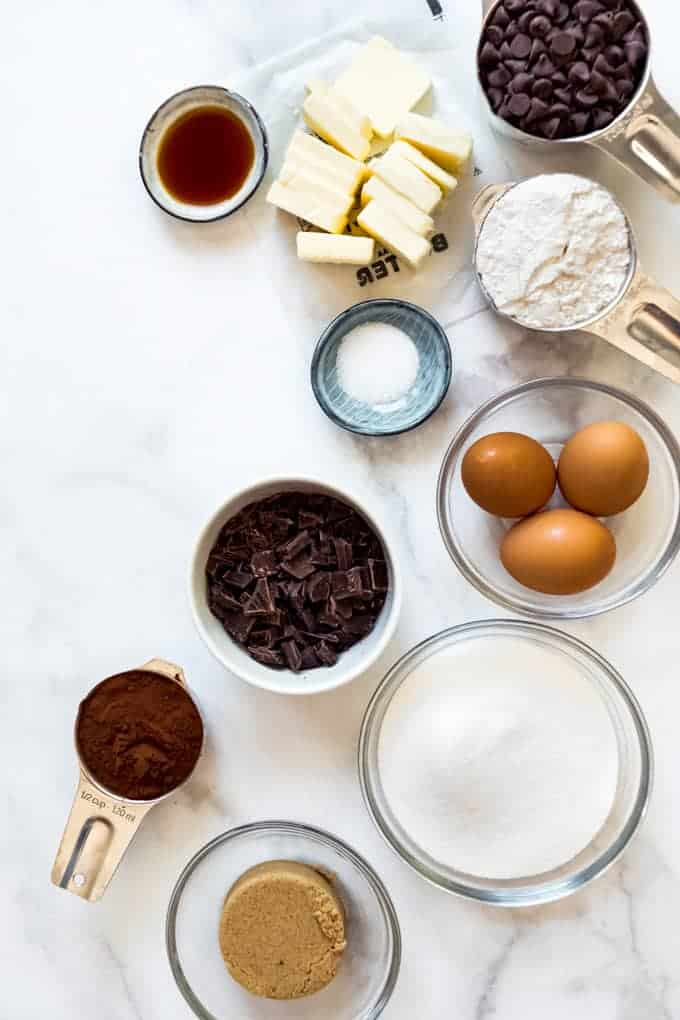 Ingredients measured into bowls and measuring cups for making brownies from scratch.