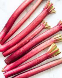 Fresh rhubarb stalks with drops of water on them.