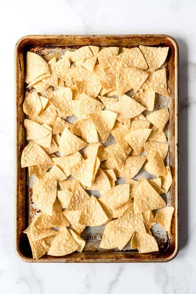 Tortilla chips on a baking sheey