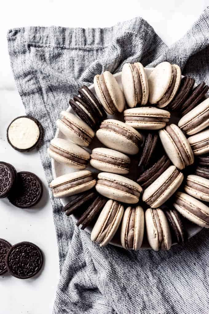 A plate of macarons with Oreo cookies.