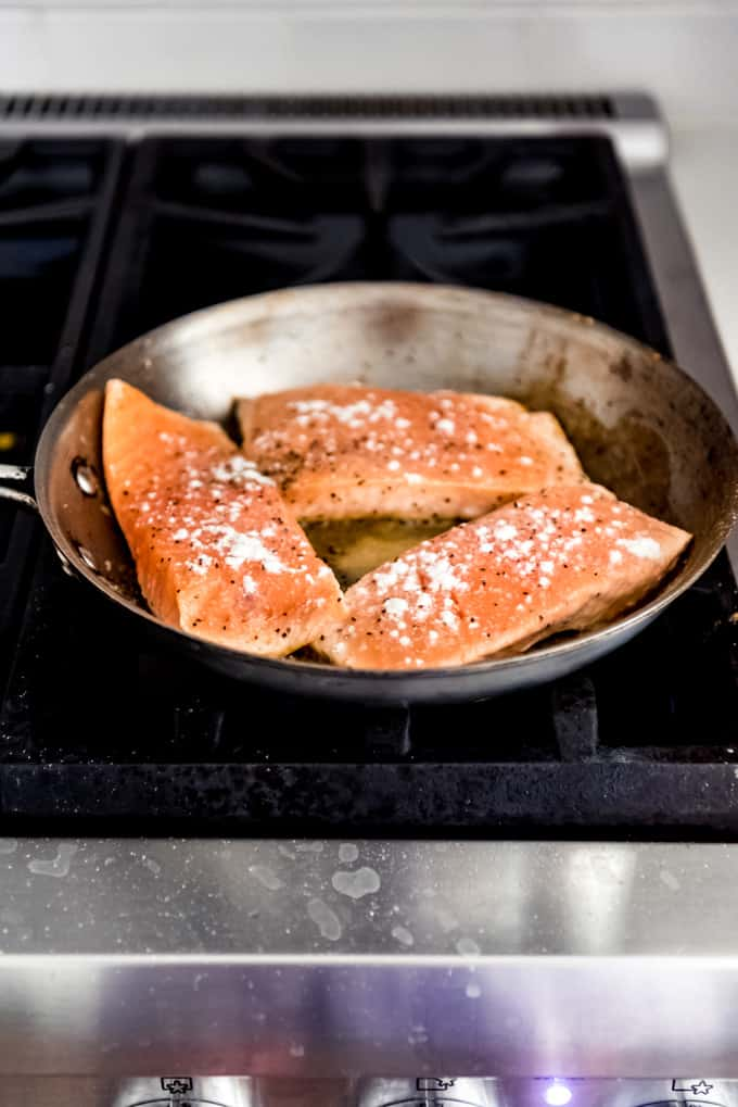 Salmon cooking in the pan