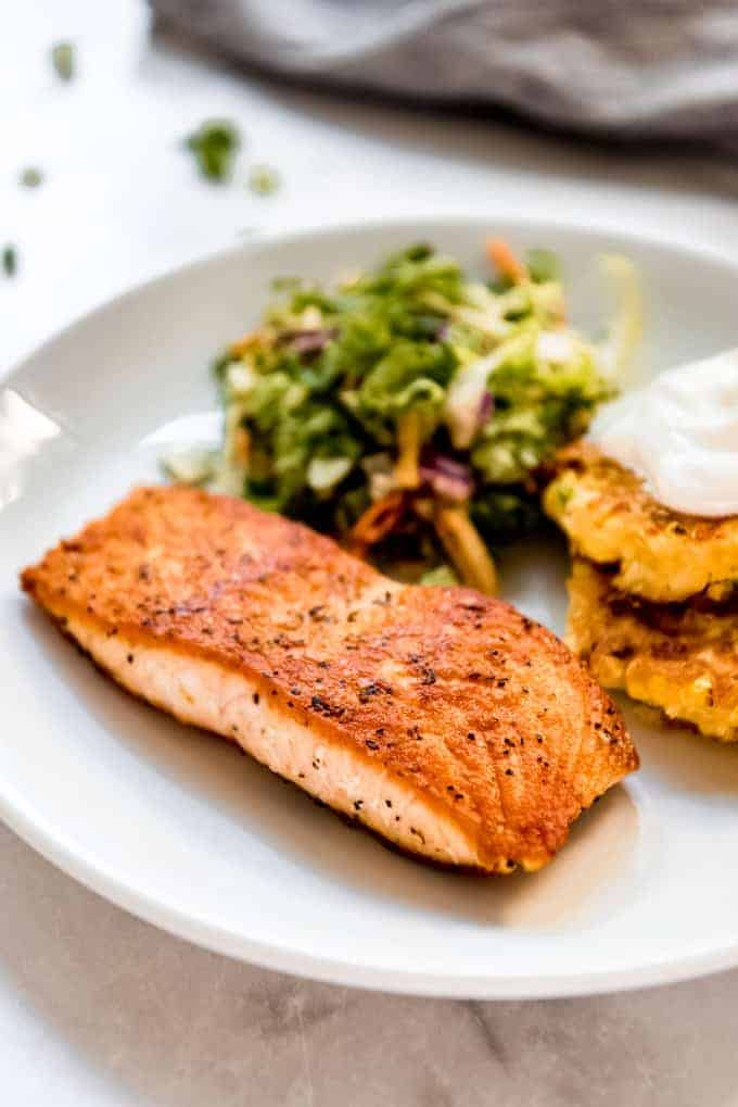 Salmon on a white plate with sides