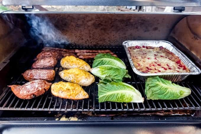 Sweet potatoes, chicken breasts, bacon, lettuce, and dump cake on a smoker at the same time.