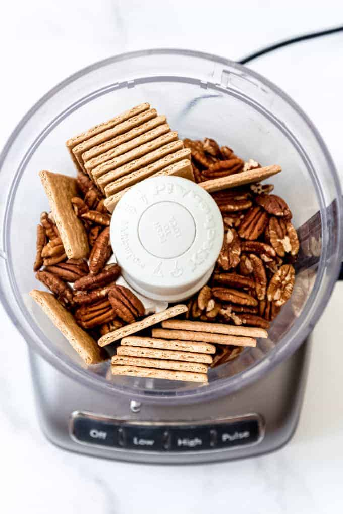 graham crackers and whole pecans in a food processor