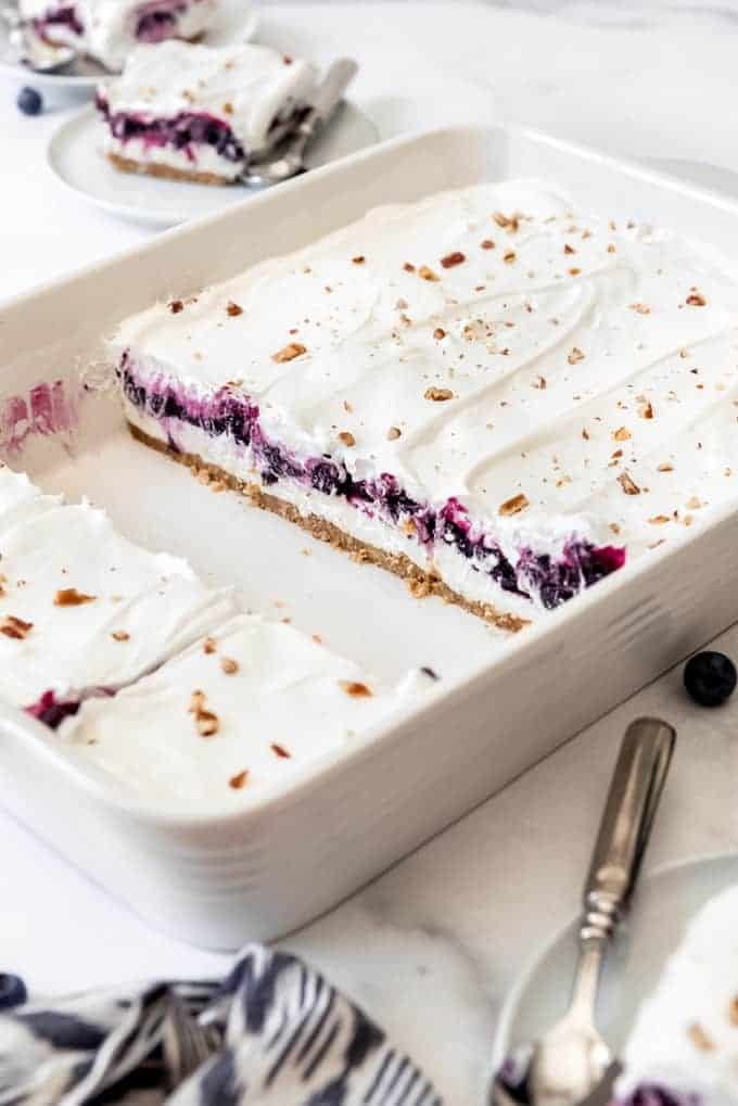 A cross-section showcasing layers of blueberry filling and no-bake cream cheese filling in blueberry delight.