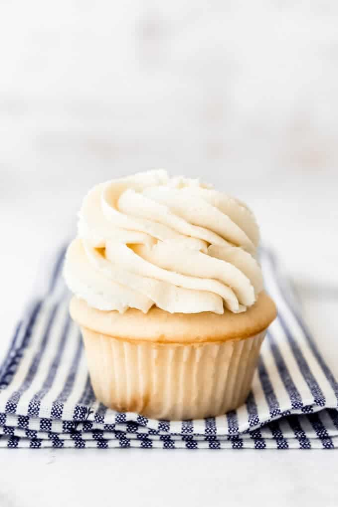 A white cupcake with swiss meringue buttercream frosting.
