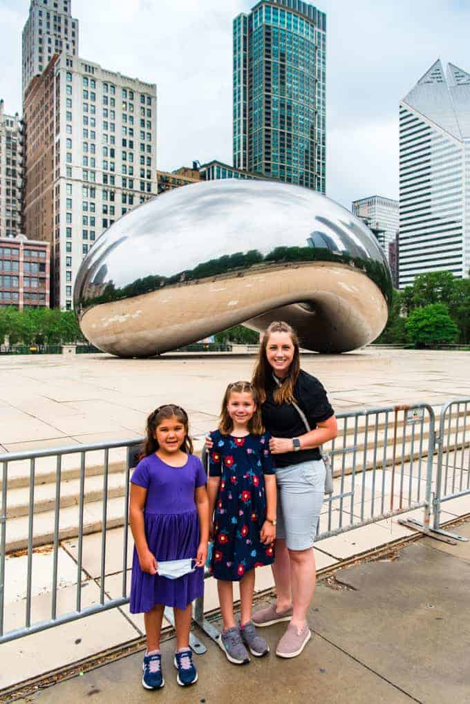 A mother and two daughters in front of the Chicago Bean.