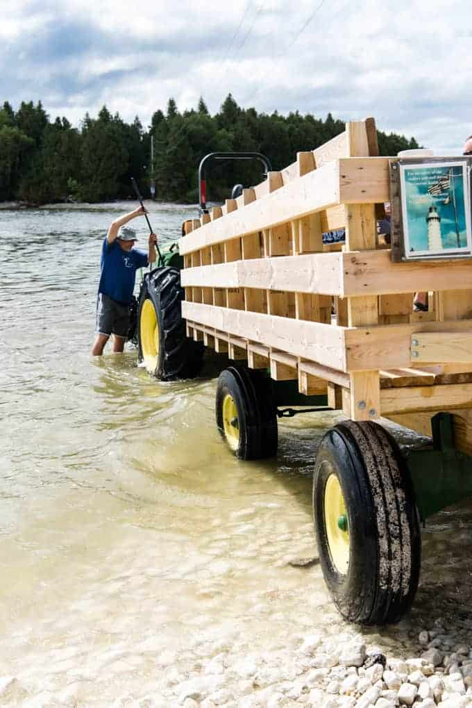 A tractor for carrying people across the causeway to Cave Point Lighthouse.