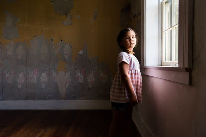 A child in front of a window in the lighthouse at Cave Point Lighthouse in Wisconsin.