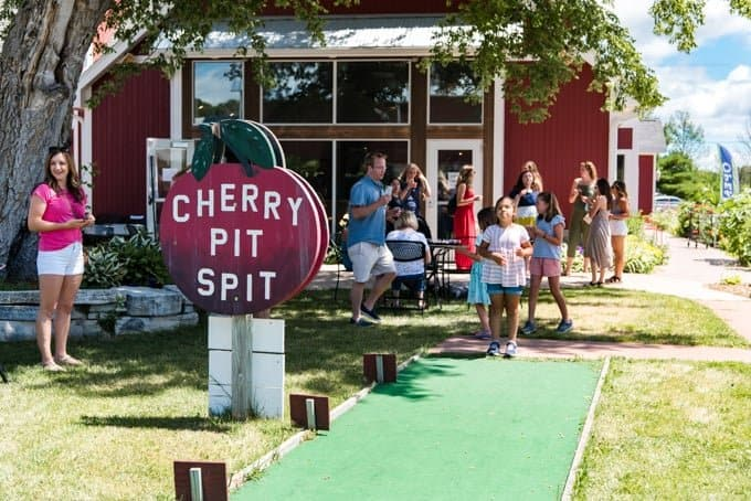 People enjoying the cherry pit spitting in Door County, Wisconsin.