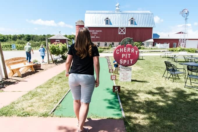 A woman at the cherry pit spit at Launtenbach's Orchard in Door County, Wisconsin.