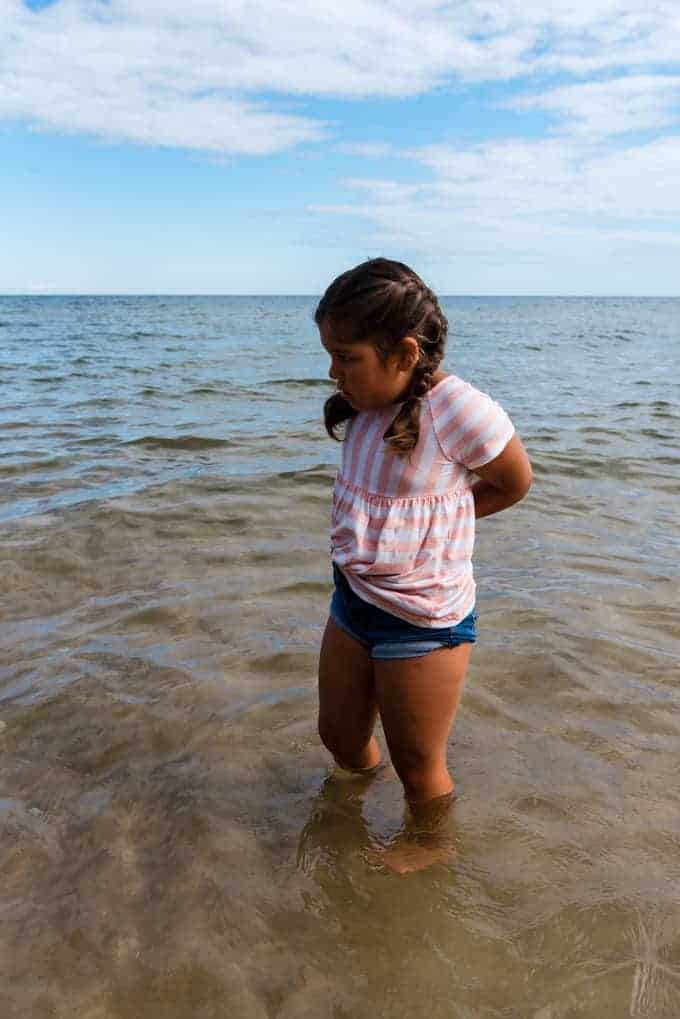 A child wading in the waters of Lake Michigan.
