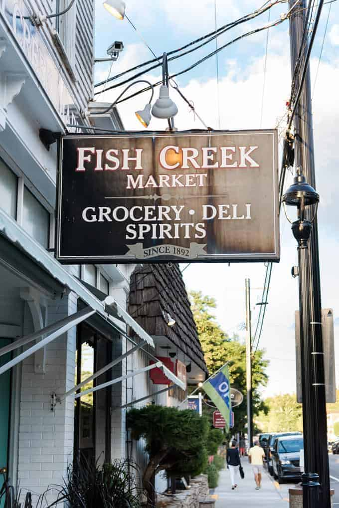 A sign for Fish Creek Market in Fish Creek, Wisconsin.