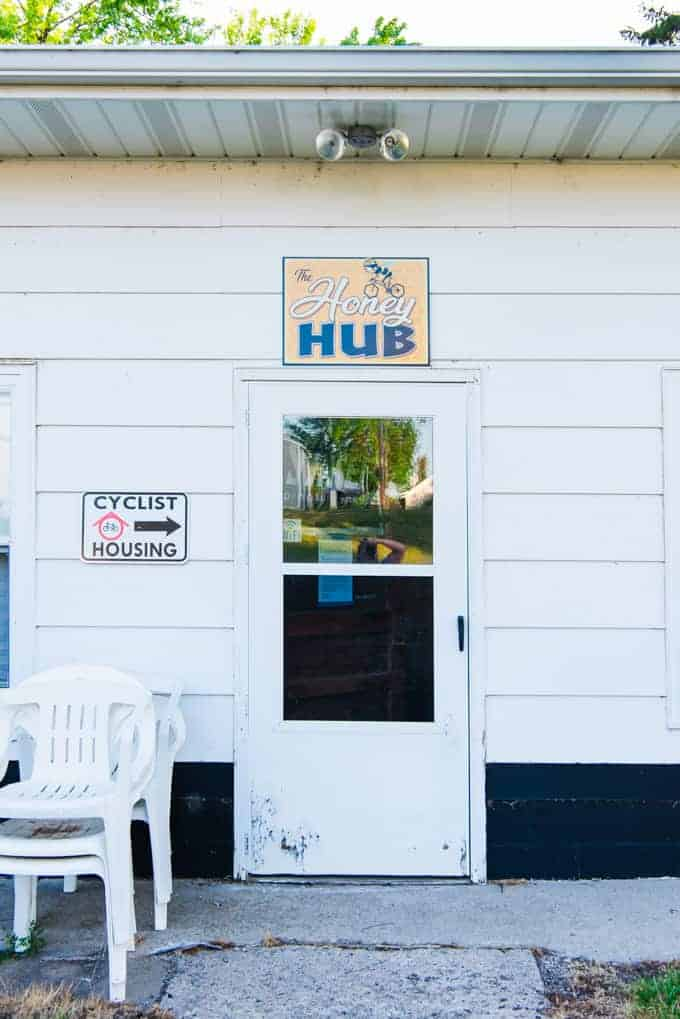 A door with the Honey Hub sign over it in Gackle, North Dakota.