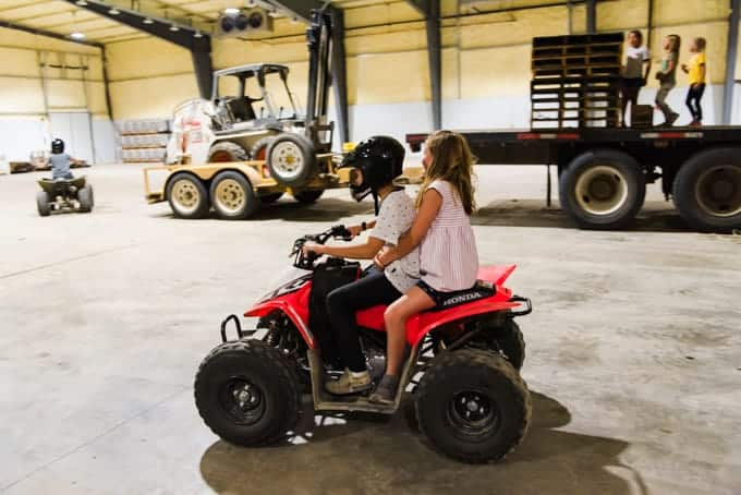 Two kids riding an ATV.