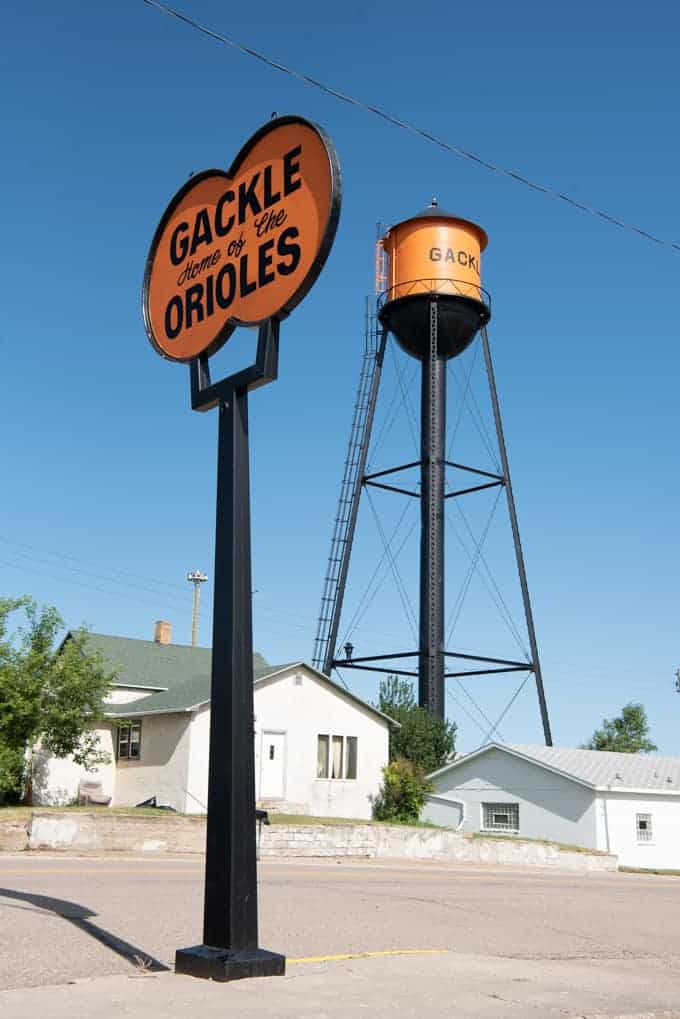 An orange and black water tower in Gackle, North Dakota.