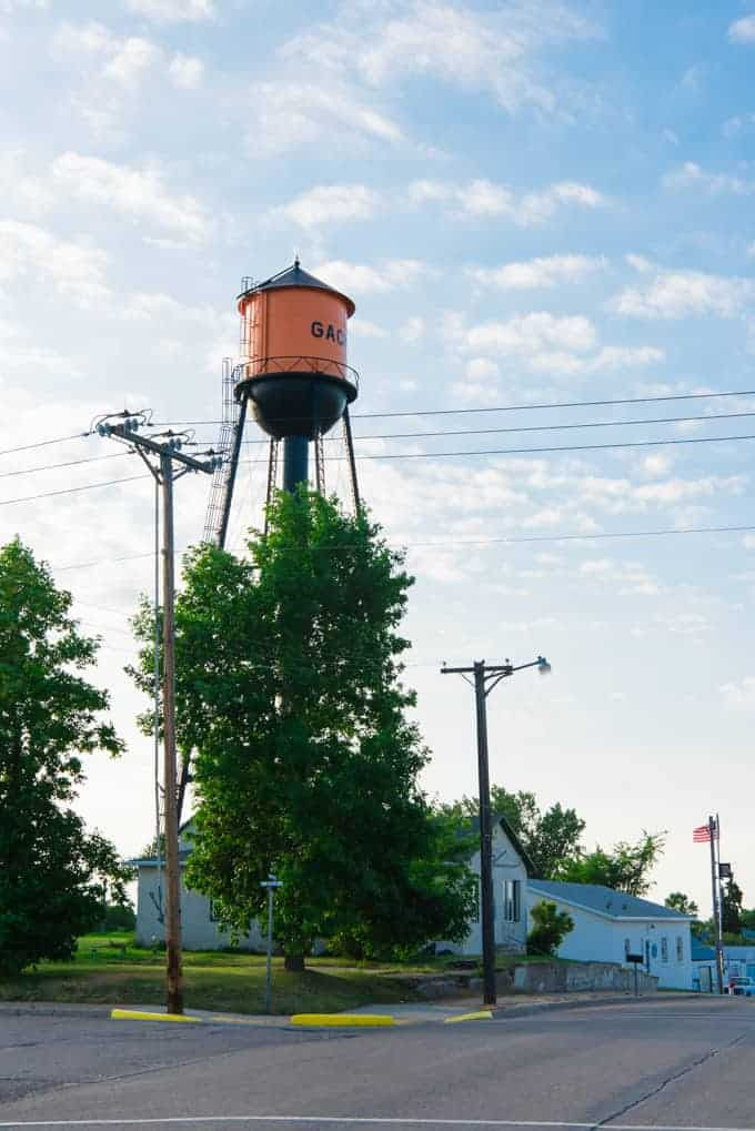 An orange and black water tower in a small North Dakota town.