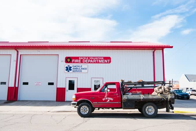 A fire station with a truck in front of it.